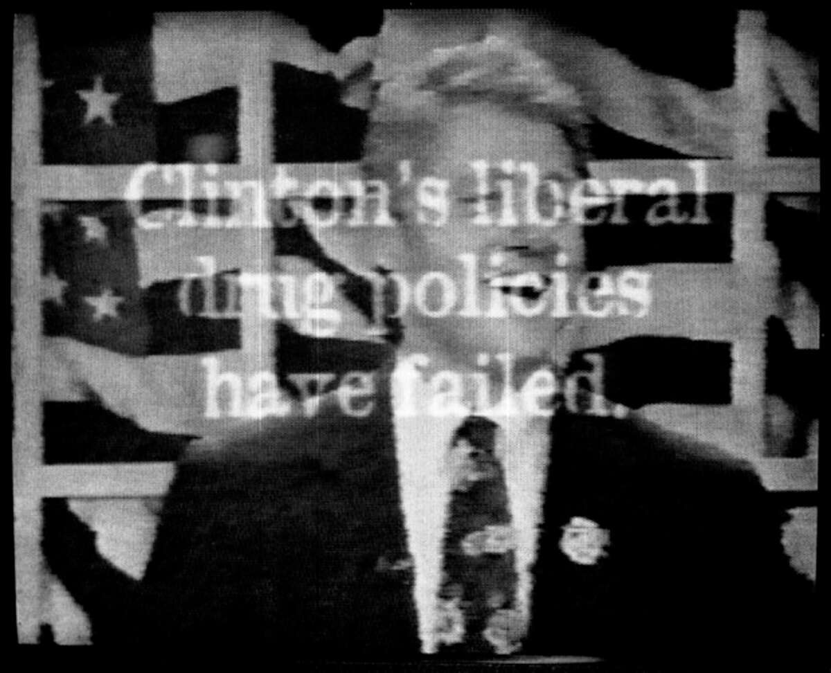 """FILE - This Sept. 20, 1996 file photo shows a television ad aired by Republican presidential candidate Bob Dole's campaign which includes footage from a 1992 MTV interview of a laughing President Clinton saying he would inhale marijuana if given the chance to relive his college days. The words on the screen read, ''Clinton's liberal drug policies have failed.'' On the occasion of ?""""Legalization Day,?"""" Thursday, Dec. 6, 2012, when Washington?'s new law takes effect, AP takes a look back at the cultural and legal status of the ?""""evil weed?"""" in American history. (AP Photo/Dole Campaign, File)"""
