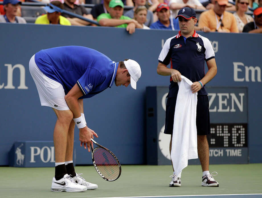 John Isner reacts after losing a point to Philipp Kohlschreiber, of Germany, during the third round of the 2013 U.S. Open tennis tournament, Saturday, Aug. 31, 2013, in New York. (AP Photo/Darron Cummings) / AP