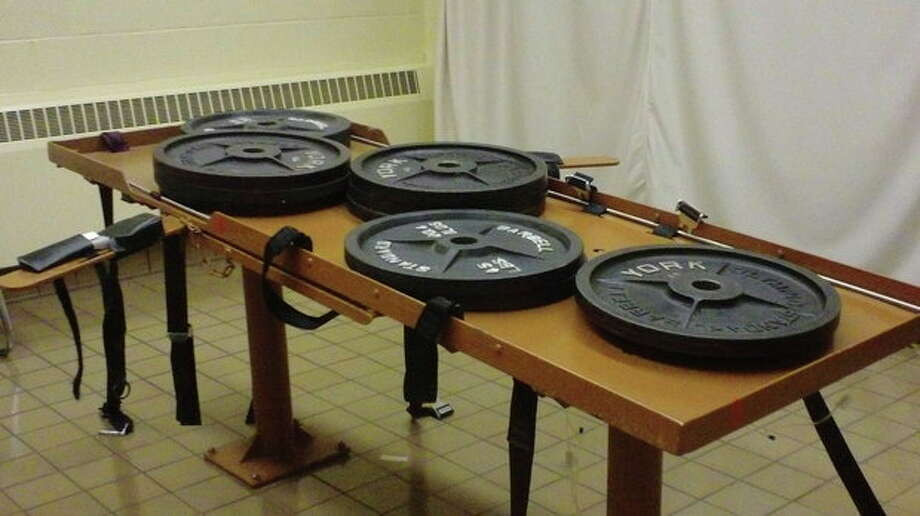 This undated photo provided by the Ohio Department of Rehabilitation and Corrections shows 540 pounds of weights placed on the execution table at the Southern Ohio Correctional Facility in Lucasville, Ohio to test the table's load bearing. Ohio death row inmate Ronald Post, scheduled for execution Jan. 16, 2013, is arguing that, at 450 pounds, can not be humanely executed under both the state's usual method and the untested backup procedure. (AP Photo/Ohio Dept. of Rehabilitation and Corrections) / Ohio Department of