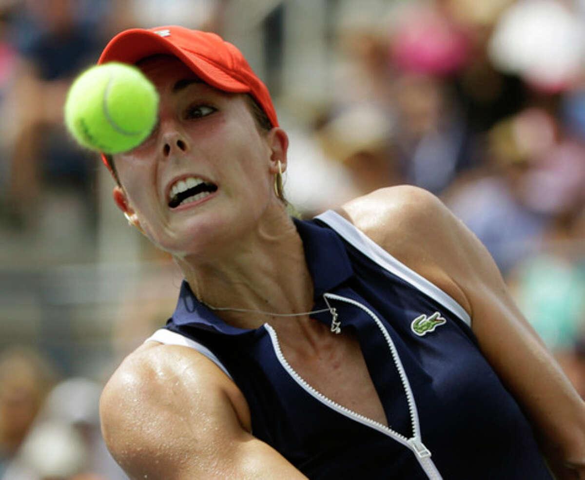 Alize Cornet, of France, returns a shot to Victoria Azarenka, of Belarus, during the third round of the 2013 U.S. Open tennis tournament, Saturday, Aug. 31, 2013, in New York. (AP Photo/David Goldman)