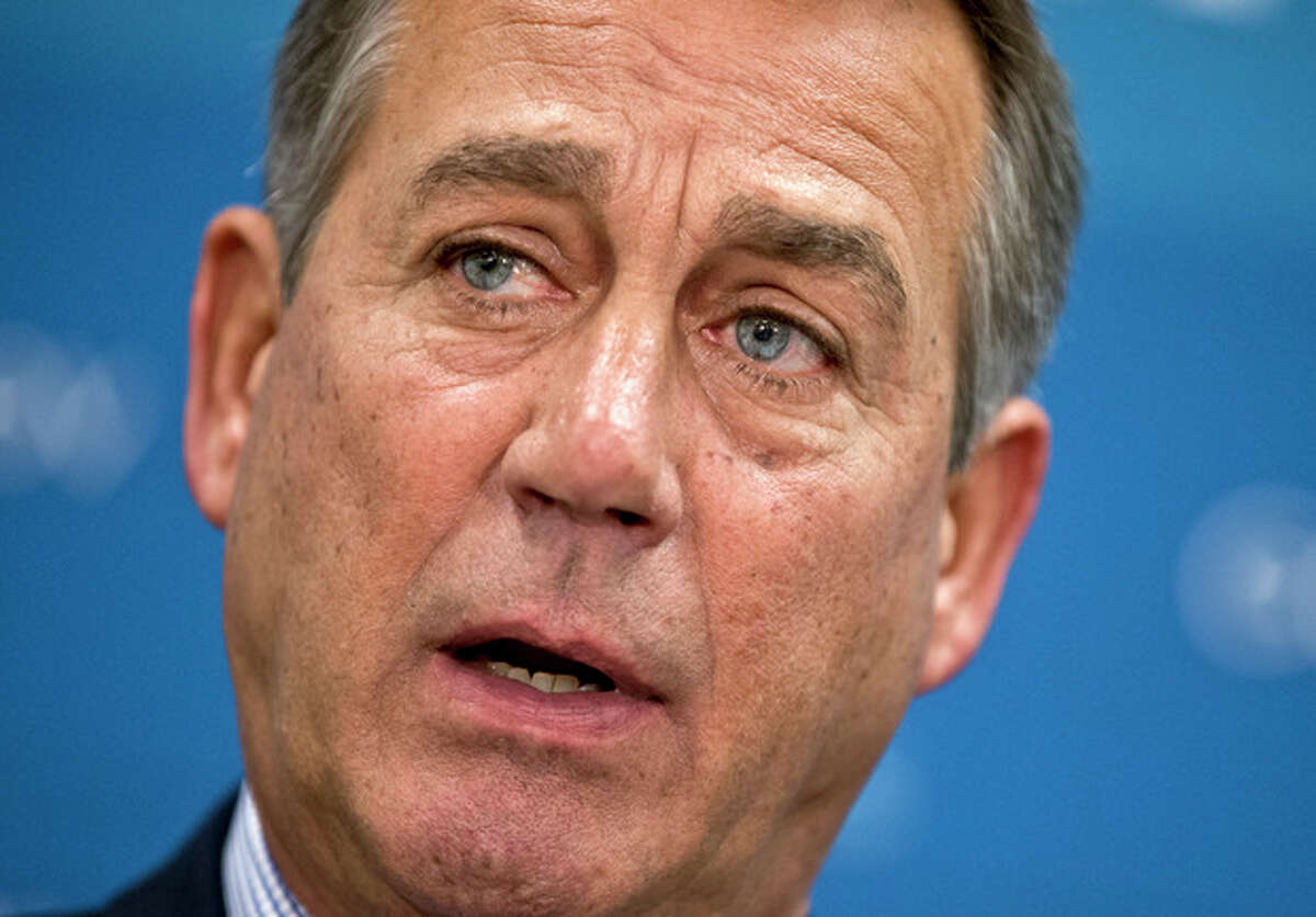 FILE - In this July 9, 2013, file photo House Speaker, Republican John Boehner of Ohio, pauses during a meeting with reporters on Capitol Hill in Washington. Congressional Republicans and Democrats are pressing President Barack Obama to explain why the U.S. military should attack Syria and involve Americans in a deadly civil conflict that has roiled the Mideast. Boehner, wrote the president on Wednesday, Aug. 28, 2013, in seeking answers as the drumbeat of war grew louder. (AP Photo/J. Scott Applewhite, File)