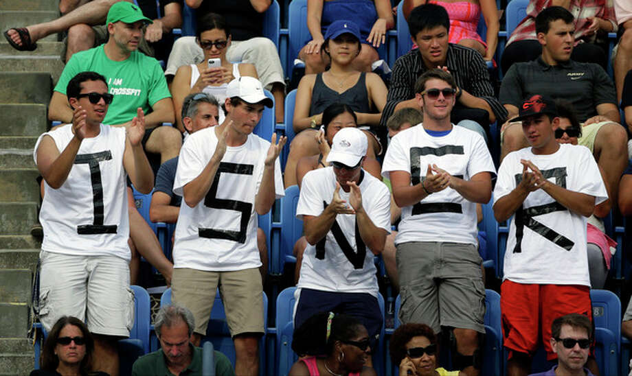 Fans cheer for John Isner during a third round match against Philipp Kohlschreiber, of Germany, at the 2013 U.S. Open tennis tournament, Saturday, Aug. 31, 2013, in New York. (AP Photo/David Goldman) / AP