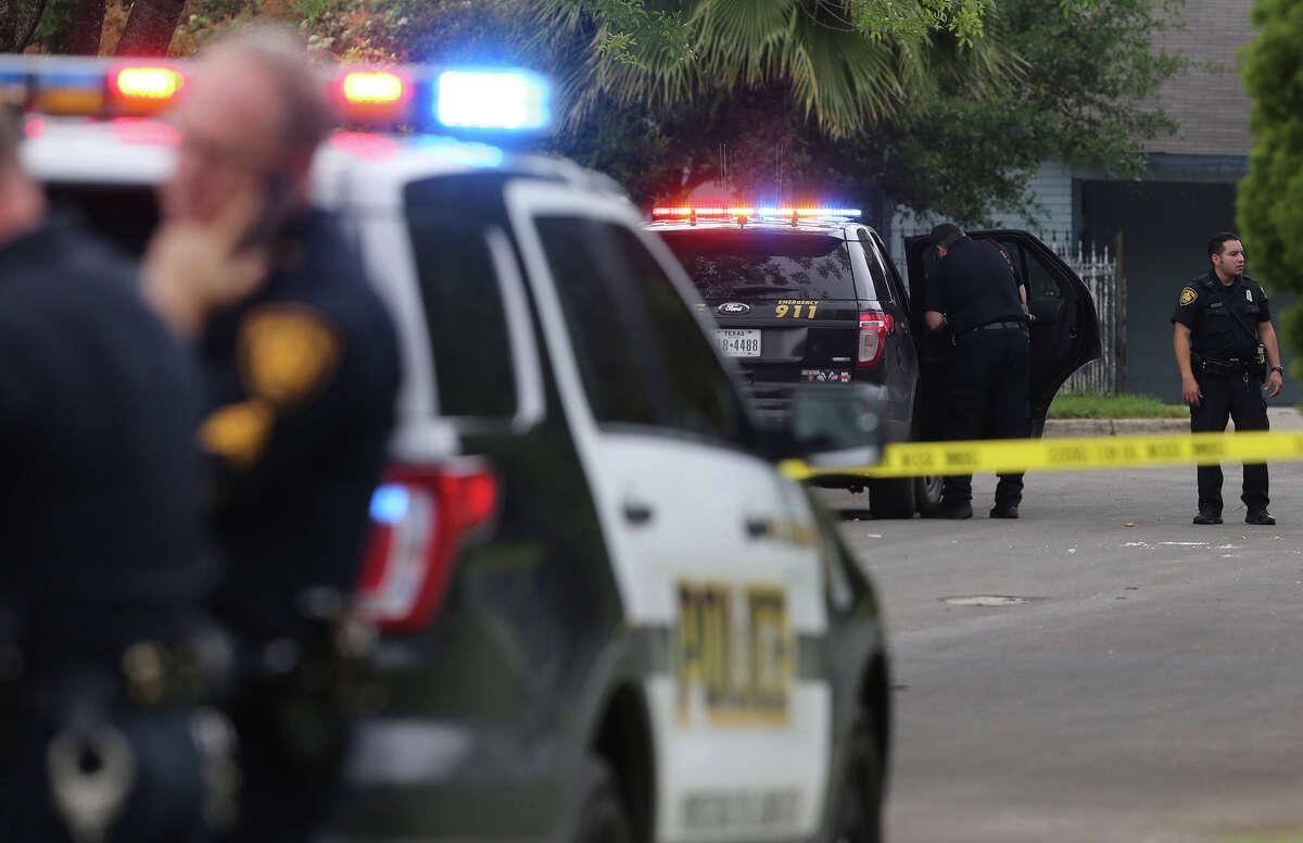 This file photo shows San Antonio police investigating an April shooting.