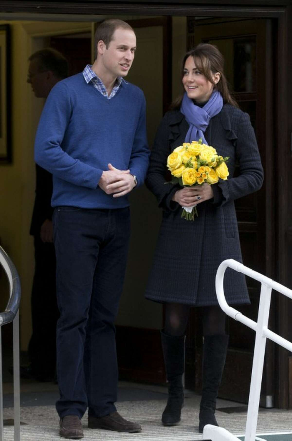 AP Photo/Alastair Grant Britain's Prince William stands next to his wife Kate, Duchess of Cambridge as she leaves the King Edward VII hospital in central London, Thursday, Dec. 6.