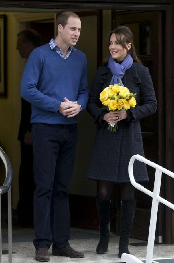 AP Photo/Alastair GrantBritain's Prince William stands next to his wife Kate, Duchess of Cambridge as she leaves the King Edward VII hospital in central London, Thursday, Dec. 6.