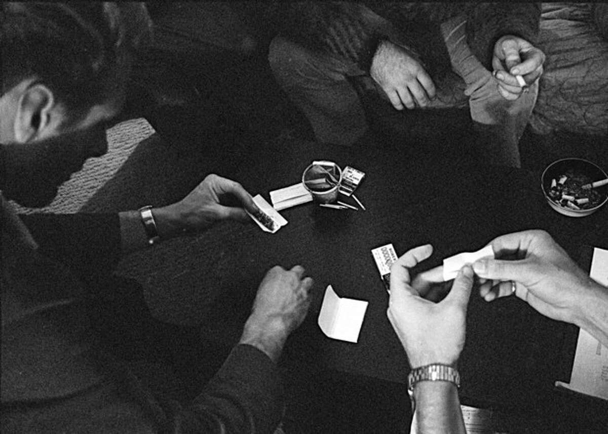 FILE - In this May 23, 1966, file photo, people roll joints at a marijuana party near the University of California at Berkeley campus in Berkeley, Calif. In 2012, Washington state and Colorado voted to legalize and regulate its recreational use. But before that, the plant, renowned since ancient times for its strong fibers, medical use and mind-altering properties, was a staple crop of the colonies, an