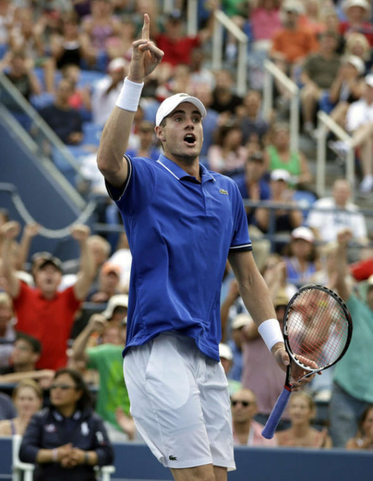 John Isner reacts after a point against Philipp Kohlschreiber, of Germany, during the third round of the 2013 U.S. Open tennis tournament, Saturday, Aug. 31, 2013, in New York. (AP Photo/Darron Cummings)