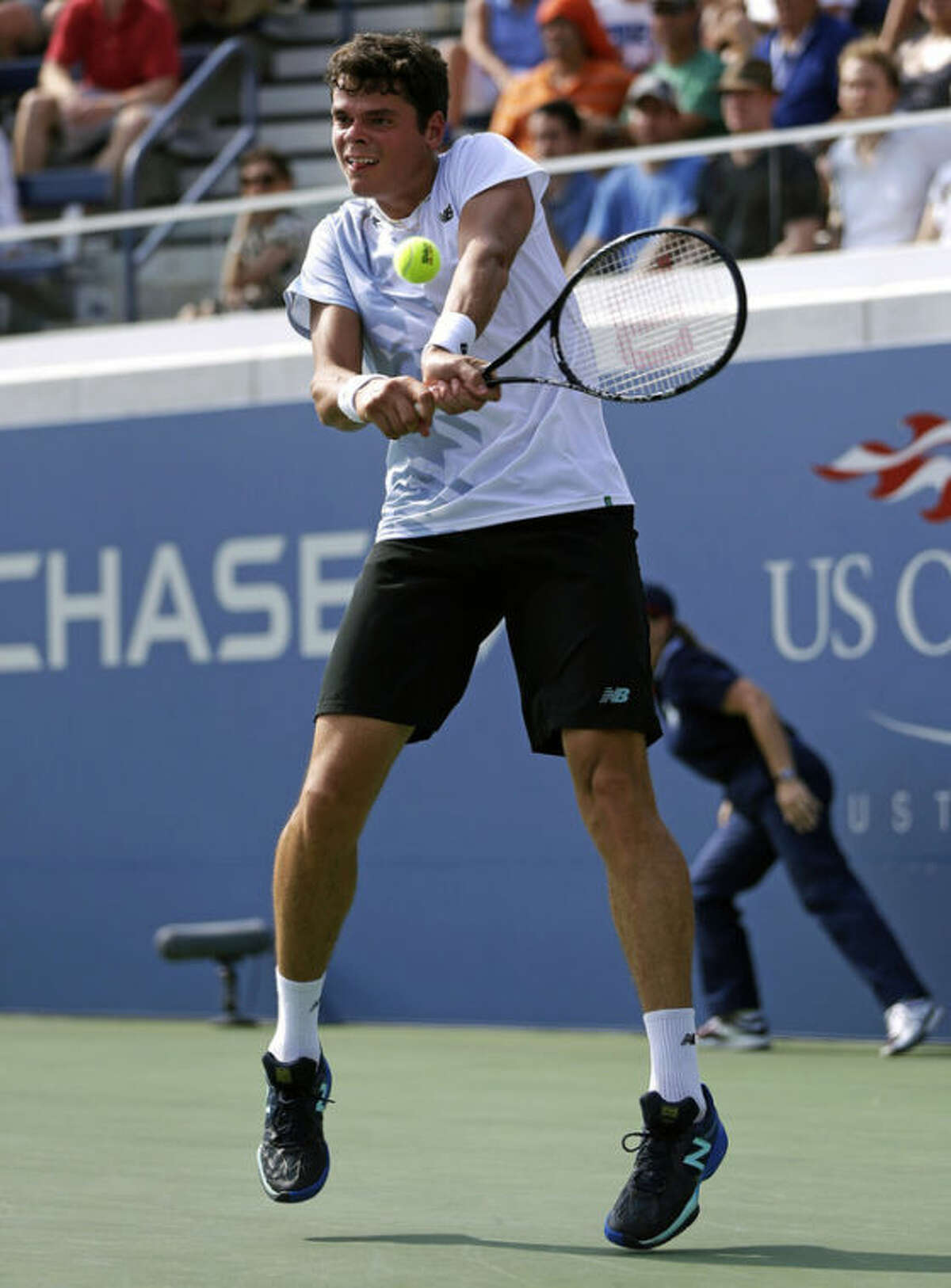 Milos Raonic, of Canada, returns a shot to Feliciano Lopez, of Spain, during the third round of the 2013 U.S. Open tennis tournament, Saturday, Aug. 31, 2013, in New York. (AP Photo/Julio Cortez)