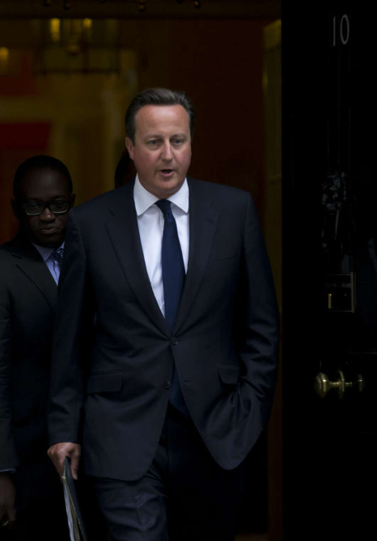Britain's Prime Minister David Cameron leaves 10 Downing Street in London, to be driven to the Houses of Parliament for a debate and vote on Syria, Thursday, Aug. 29, 2013. Britain's opposition Labour Party has indicated it may not support even a watered down version of a government resolution on Syria. Labour leader Ed Miliband said Thursday he is unwilling to give Prime Minister David Cameron a