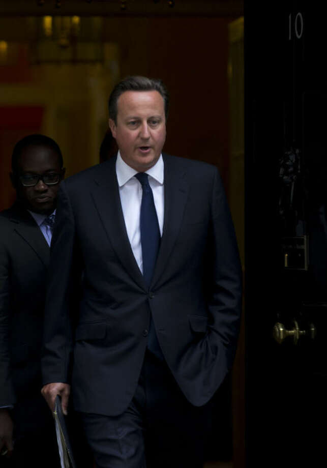 """Britain's Prime Minister David Cameron leaves 10 Downing Street in London, to be driven to the Houses of Parliament for a debate and vote on Syria, Thursday, Aug. 29, 2013. Britain's opposition Labour Party has indicated it may not support even a watered down version of a government resolution on Syria. Labour leader Ed Miliband said Thursday he is unwilling to give Prime Minister David Cameron a """"blank check"""" for conducting possible future military operations against Syria. (AP Photo/Matt Dunham)"""