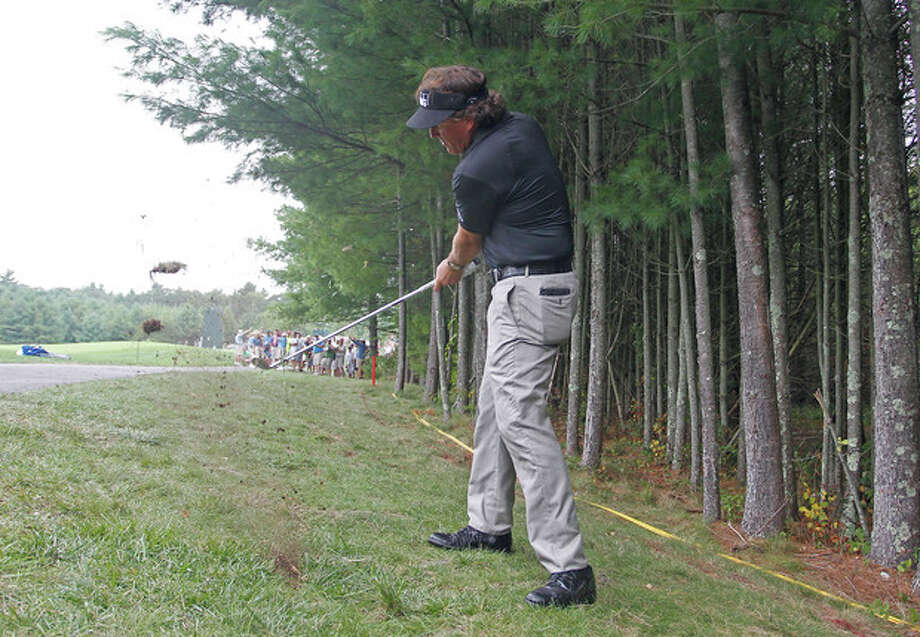 Phil Mickelson hits his second shot on the 10th hole during the second round of the Deutsche Bank Championship golf tournament in Norton, Mass., Saturday, Aug. 31, 2013. (AP Photo/Stew Milne) / FR56276 AP