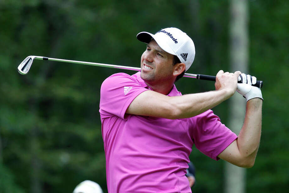 Sergio Garcia, form Spain, watches his tee shot on the eighth hole during the second round of the Deutsche Bank Championship golf tournament in Norton, Mass., Saturday, Aug. 31, 2013. (AP Photo/Stew Milne) / FR56276 AP