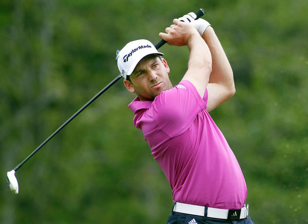 Sergio Garcia, from Spain, tees off on the 17th hole during the second round of the Deutsche Bank Championship golf tournament in Norton, Mass., Saturday, Aug. 31, 2013. (AP Photo/Stew Milne)