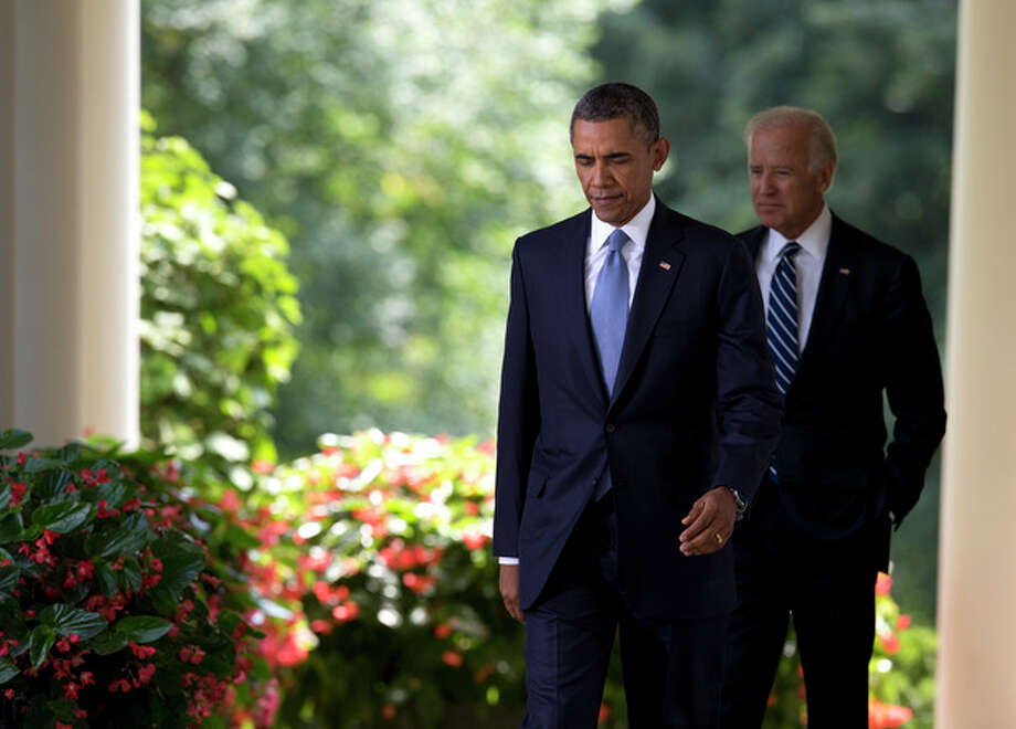President Barack Obama arrives with Vice President Joe Biden, right, to make a statement about the crisis in Syria in the Rose Garden at the White House in Washington, Saturday, Aug. 31, 2013. Delaying what had appeared to be an imminent strike, Obama abruptly announced Saturday he will seek congressional approval before launching any military action meant to punish Syria for its alleged use of chemical weapons in an attack that killed hundreds. (AP Photo/Evan Vucci) / AP