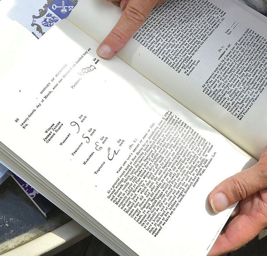 Hour Photo/Alex von Kleydorff A book about Stamford history shows family signatures on a treaty document