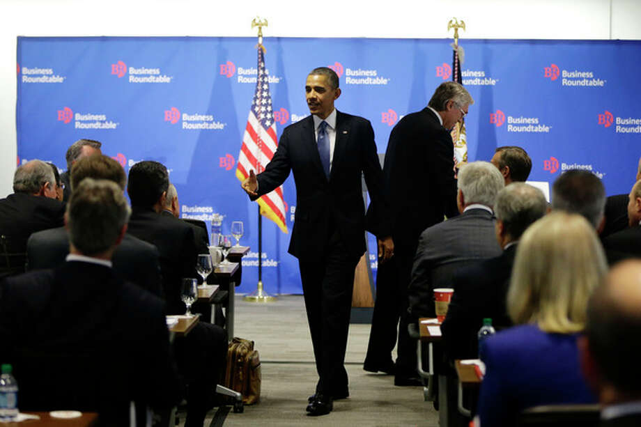 AP Photo/Charles DharapakPresident Barack Obama walks over to shake hands with business leaders before speaking about the fiscal cliff during an address before the Business Roundtable, an association of chief executive officers, Wednesday, Dec. 5, 2012, in Washington. / AP