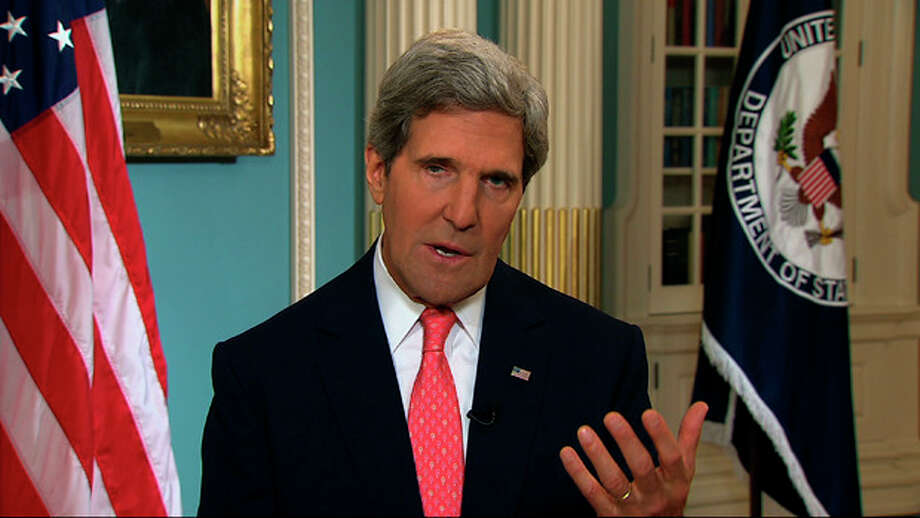 """In this image from video U.S. Secretary of State John Kerry speaks from the State Department in Washington Sunday, Sept. 1, 2013, making a case for U.S. intervention in Syria. Kerry appeared at State in a series of interviews for Sunday news shows to say the case for intervention in Syria's two-and-a-half-year civil war was strengthening each day and that he expected American lawmakers to recognize the need for action when the """"credibility of the United States is on the line."""" (AP Photo/APTN) / APTN"""