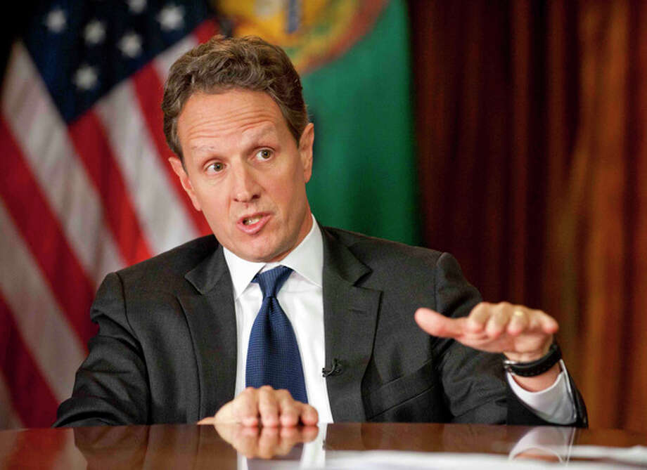 "In this Nov. 30, 2012, photo provided by CBS News Treasury Secretary Timothy Geithner answers questions about averting the ""fiscal cliff"" on an episode of ""Face the Nation"" on Sunday, Dec. 2, 2012 Geithner said Republicans have to stop using fuzzy ""political math"" and say how much they are willing to raise tax rates on the wealthiest 2 percent of Americans and then specify the spending cuts they want. (AP Photo/CBS News, Chris Usher) / CBS News"
