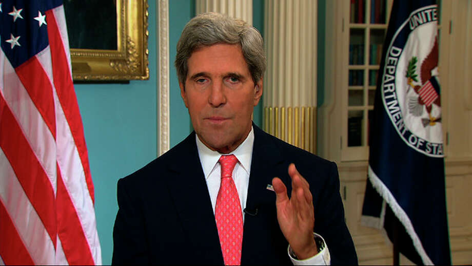 """In this image from video U.S. Secretary of State John Kerry speaks from the State Department in Washington Sunday, Sept. 1, 2013, making a case for U.S. intervention in Syria. Kerry appeared at State in a series of interviews on Sunday news shows to say that the case for intervention in Syria's 2 1/2-year civil war was strengthening each day and that he expected American lawmakers to recognize the need for action when the """"credibility of the United States is on the line."""" He said President Barack Obama has the authority to launch retaliatory strikes with or without Congress' approval, but Kerry stopped short of saying the president would do so if the House or Senate withholds support. (AP Photo/APTN) / APTN"""