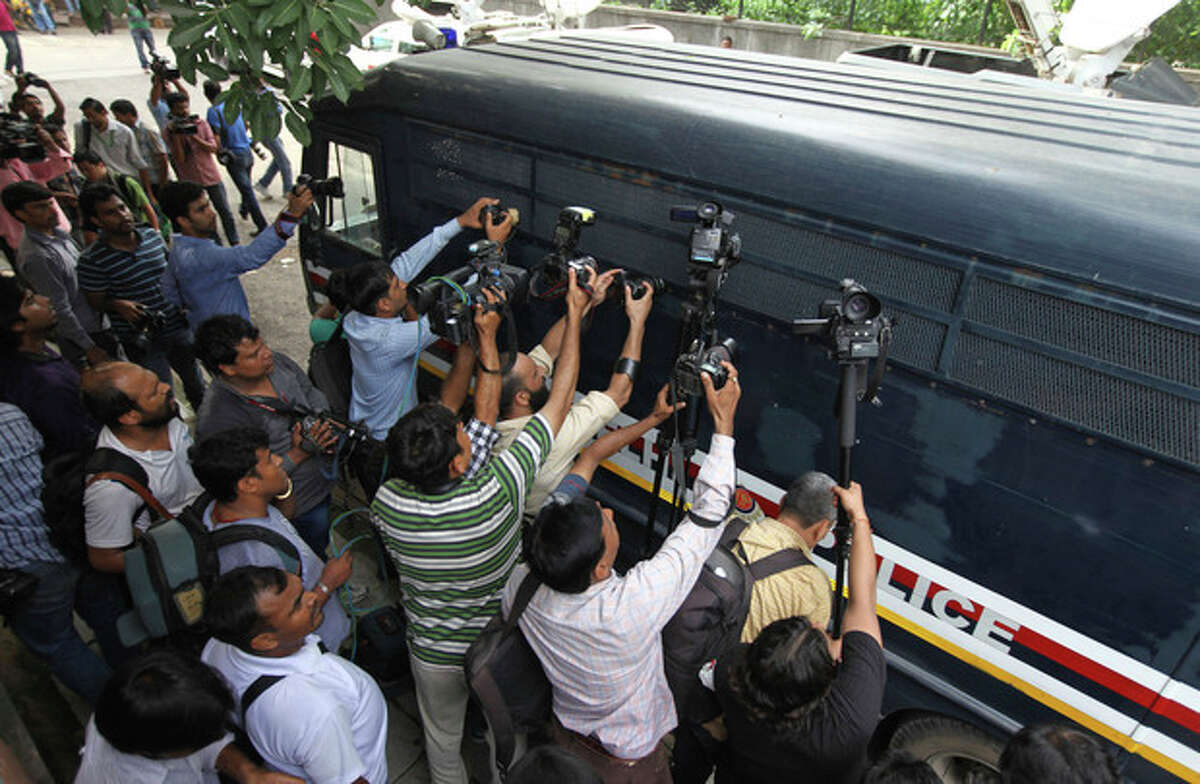 Media personnel crowd around a van carrying a juvenile convicted of rape, outside the Juvenile justice board in New Delhi, India, Saturday, Aug. 31, 2013. An Indian juvenile court on Saturday handed down the first conviction in the fatal gang rape of a young woman on a moving New Delhi bus, convicting the teenager of rape and murder and sentencing him to three years in a reform home, lawyers said. (AP Photo/Altaf Qadri)