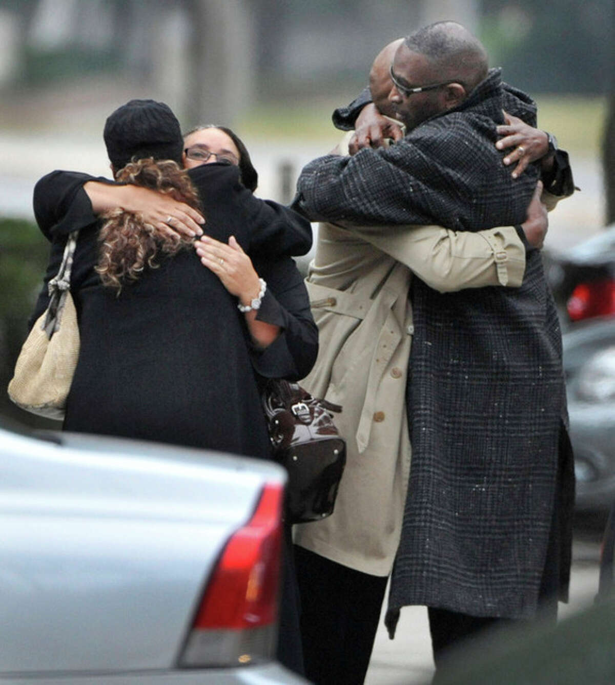 Ron Davis, the father of Jordan Davis is embraced as he arrives at the funeral home for the visitation and a memorial service for his son Jordan, Wednesday, Nov. 28, 2012 in Jacksonville, Fla. Michael David Dunn has been charged with fatally shooting Davis outside a Jacksonville convenience store following an argument that was triggered because the music coming from the teen's car was too loud. (AP Photo/The Florida Times-Union, Bob Self)