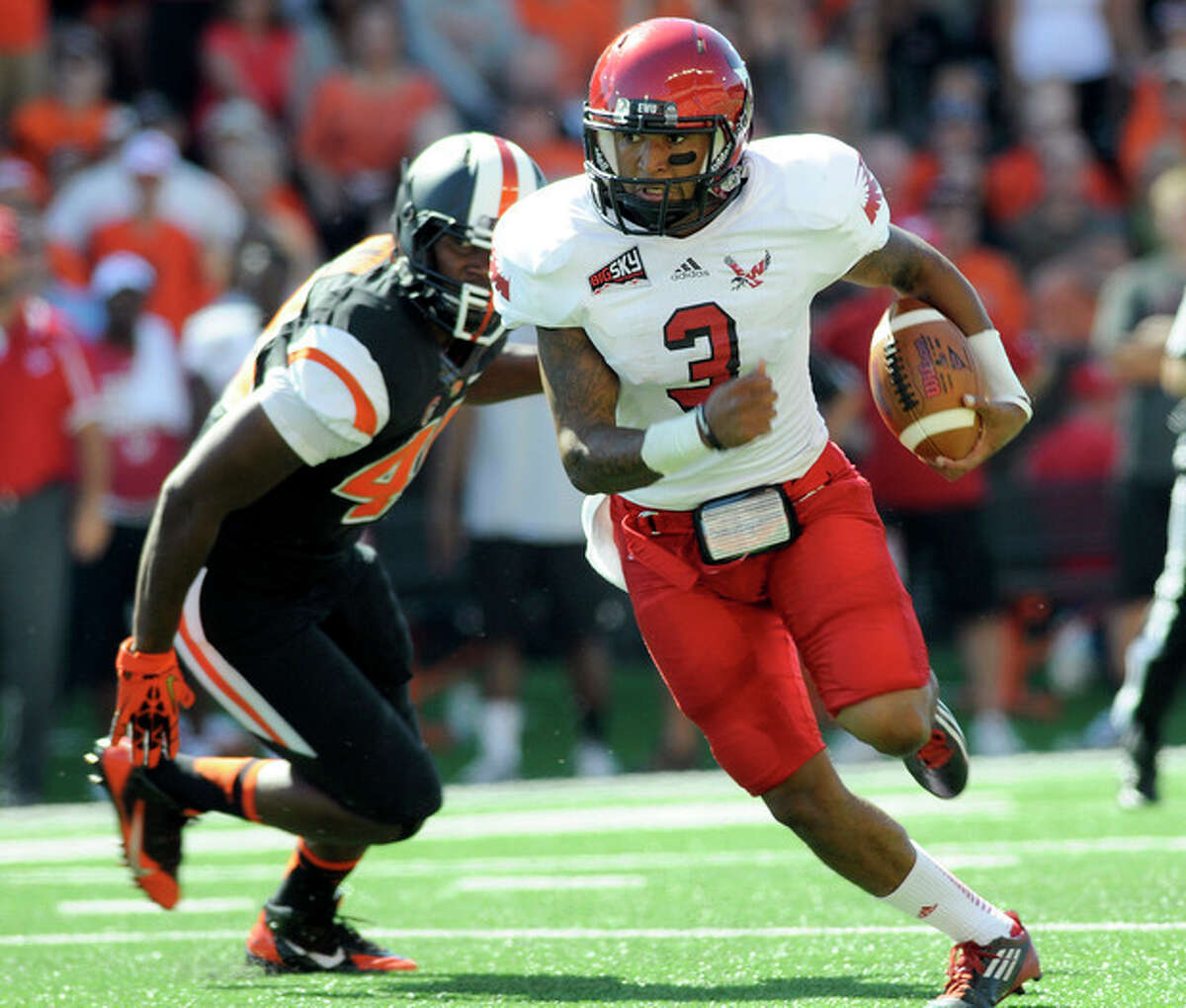 Eastern Washington's Vernon Adams Jr. (3) runs against Oregon State during an NCAA college football game, Saturday, Aug. 31, 2013, in Corvallis, Ore. Adams passed for 411 yards and ran for 107 to lead Eastern Washington to a 49-46 victory over No. 25 Oregon State. (AP Photo/Corvallis Gazette-Times, Andy Cripe)