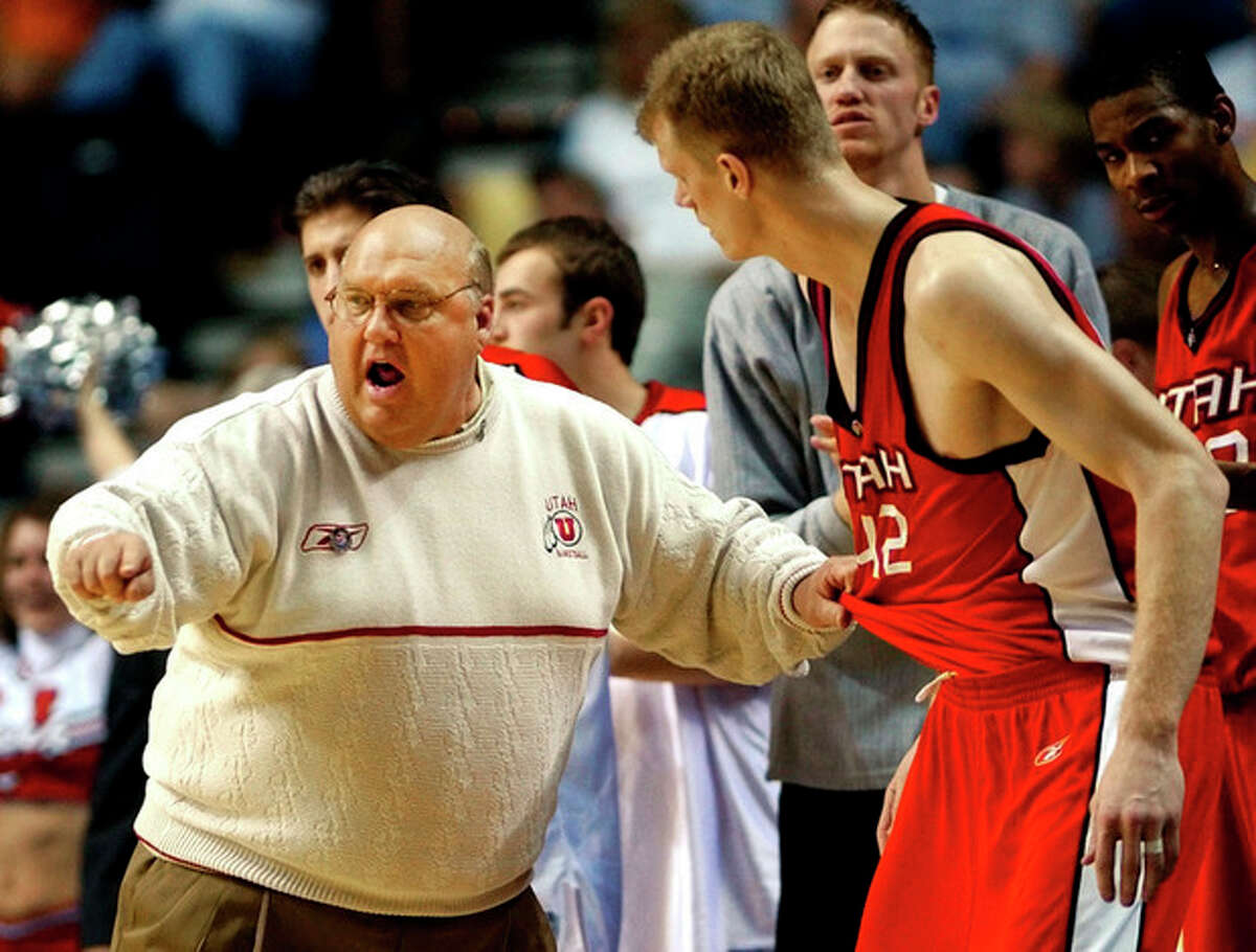 FILE - In this March 23, 2003, file photo, Utah head coach Rick Majerus instructs center Cameron Koford (42) before sending him into the game against Kentucky in the first half at the NCAA Midwest Regional basketball tournament in Nashville, Tenn. Majerus, the jovial college basketball coach who led Utah to the 1998 NCAA final and had only one losing season in 25 years with four schools, died Saturday, Dec. 1, 2012. He was 64. (AP Photo/Al Behrman, File)