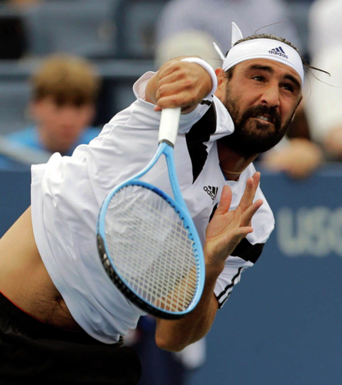 Marcos Baghdatis, of Cyprus, serves to Stanislas Wawrinka, of Switzerland, during the third round of the 2013 U.S. Open tennis tournament, Sunday, Sept. 1, 2013, in New York. (AP Photo/Mike Groll)