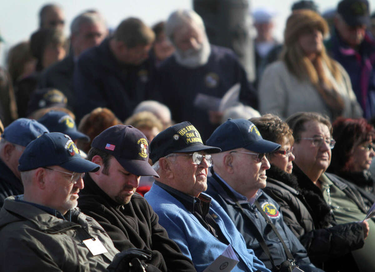 Hundreds of USS Enterprise alumni gather on the ship's flight deck Friday, Nov. 30, 2012, to honor those killed in the Jan. 14, 1969 fire, in Norfolk, Va. Thousands of alumni will visit the ship this weekend during the carrier's inactivation ceremony events at Naval Station Norfolk. (AP Photo/The Virginian-Pilot, Stephen M. Katz) MAGS OUT