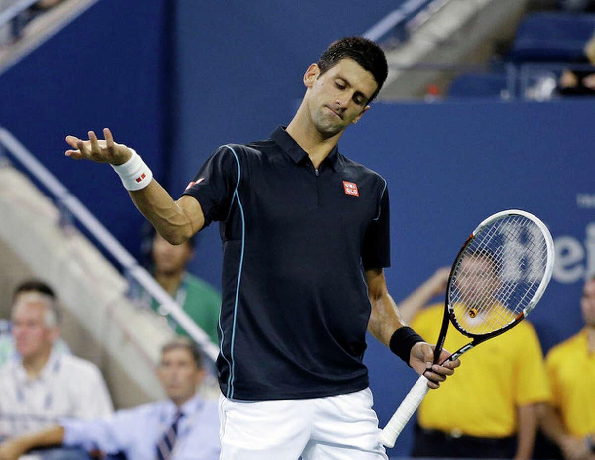 Novak Djokovic, of Serbia, reacts following a shot toJoao Sousa, of Portugal, during a third round match at the U.S. Open tennis tournament, Sunday, Sept. 1, 2013, in New York. (AP Photo/Darron Cummings)