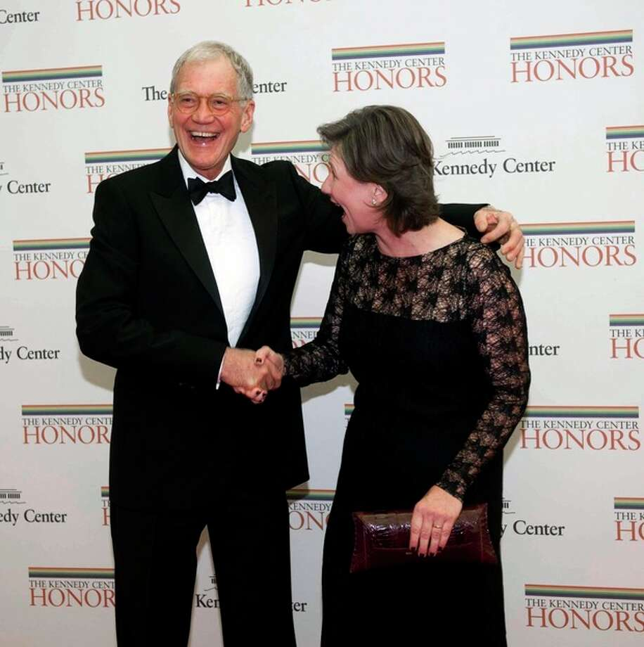 2012 Kennedy Center Honoree comedian David Letterman shakes hands with his wife Regina as they arrive at the State Department for the Kennedy Center Honors Gala Dinner on Saturday, Dec. 1, 2012 in Washington. (AP Photo/Kevin Wolf) / FR33460 AP