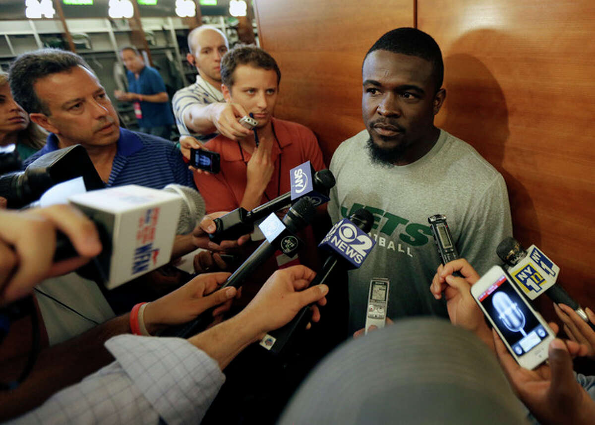 New York Jets running back Mike Goodson speaks to reporters during NFL football training camp, Tuesday, Aug. 27, 2013, in Florham Park, N.J. The NFL has suspended Goodson for the first four games of the regular season for violating the league's substance abuse policy. (AP Photo/Julio Cortez)