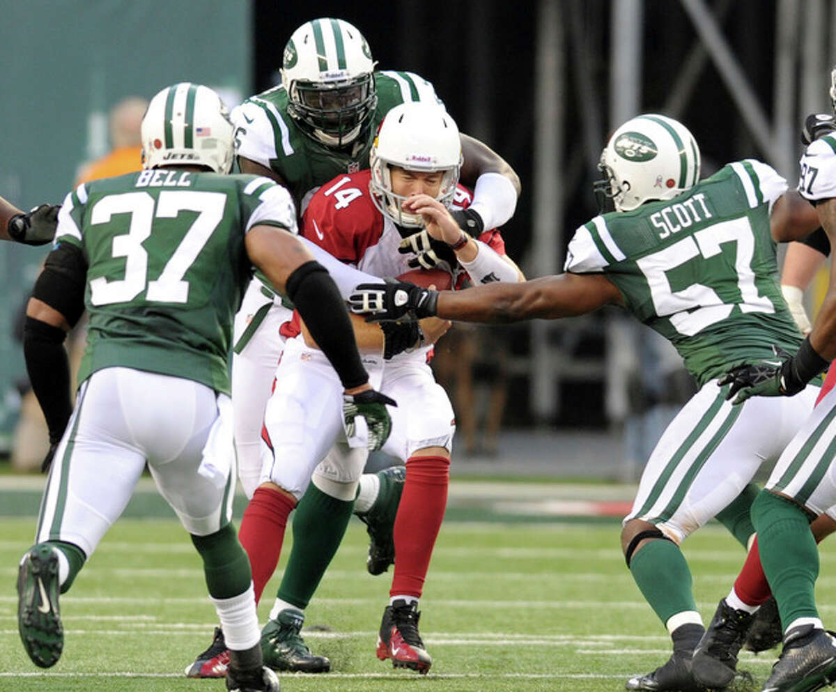 Arizona Cardinals quarterback Ryan Lindley (14) is sacked by New York Jets defensive end Muhammad Wilkerson, back, as safety Yeremiah Bell (37) and linebacker Bart Scott (57) help defend during the second half of an NFL football game, Sunday, Dec. 2, 2012, in East Rutherford, N.J. The Jets won 7-6. (AP Photo/Bill Kostroun)
