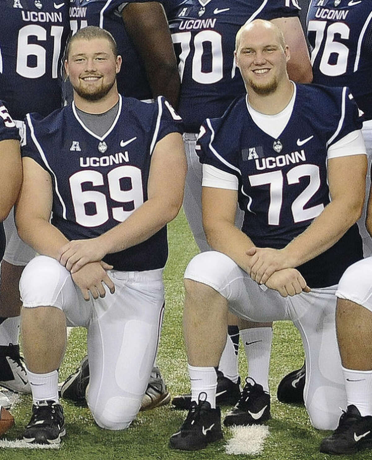 UConn senior linemen, from left, Stephen Greene and Jimmy Bennett were all smiles for the team's media day photo, but how much they'll be smiling this season will be dependent upon how well the 'O' line plays. AP photo