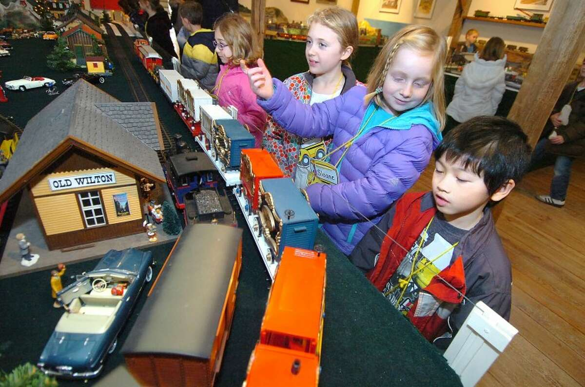 Hour Photo/Alex von Kleydorff. L-R Second Graders Isabella Furman, Sloane Sullivan and Ray Lai get a close look at passing trains at The Wilton Historical Society's Great Trains exhibit