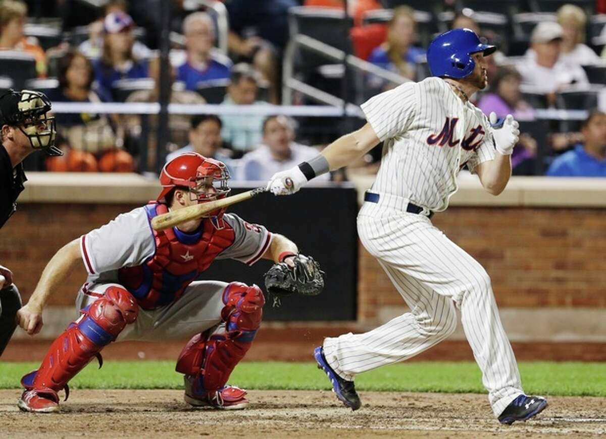 New York Mets' Jonathon Niese, right, follows through with a three-run double as Philadelphia Phillies catcher Erik Kratz looks on during the sixth inning of a baseball game Tuesday, Aug. 27, 2013, in New York. (AP Photo/Frank Franklin II)