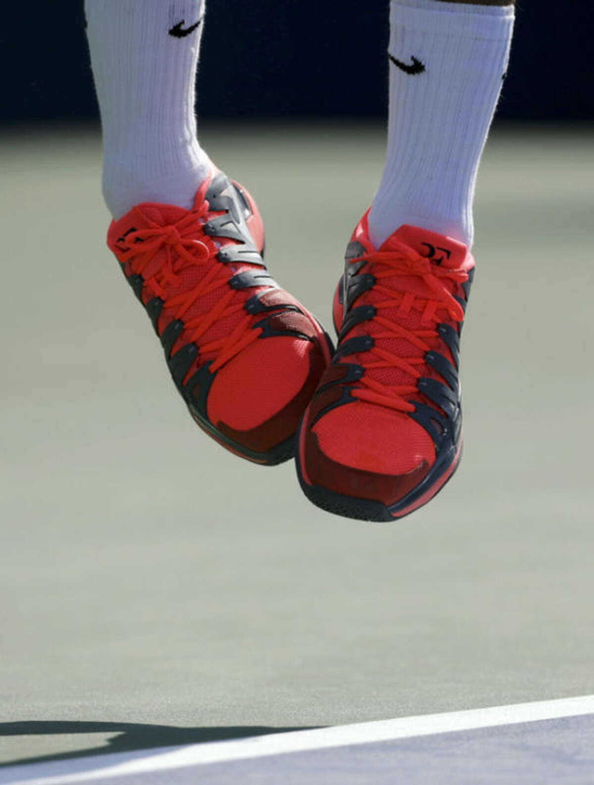 Roger Federer, of Switzerland, serves against Grega Zemlja, of Slovenia, during the first round of the 2013 U.S. Open tennis tournament, Tuesday, Aug. 27, 2013, in New York. (AP Photo/Mike Groll)