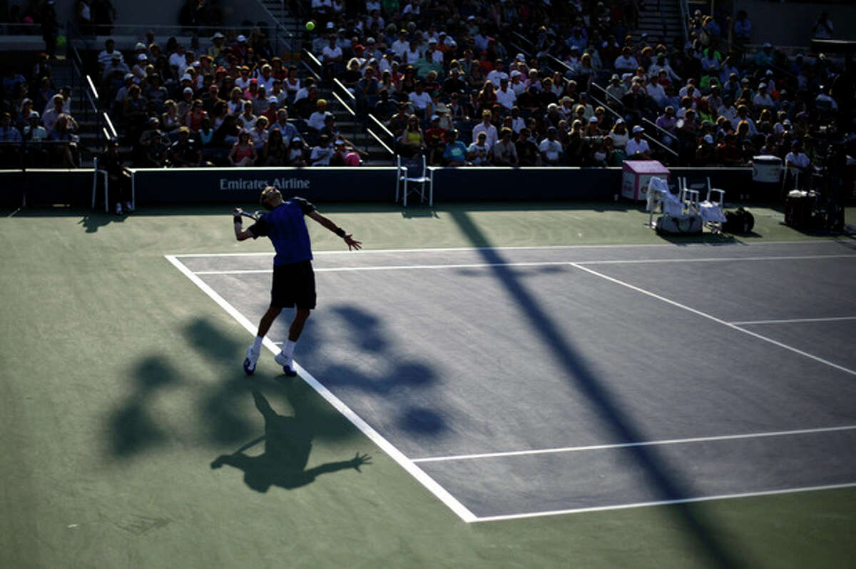 Paul-Henri Mathieu, of France, serves to Tommy Haas, of Germany, during the first round of the 2013 U.S. Open tennis tournament Tuesday, Aug. 27, 2013, in New York. (AP Photo/David Goldman)