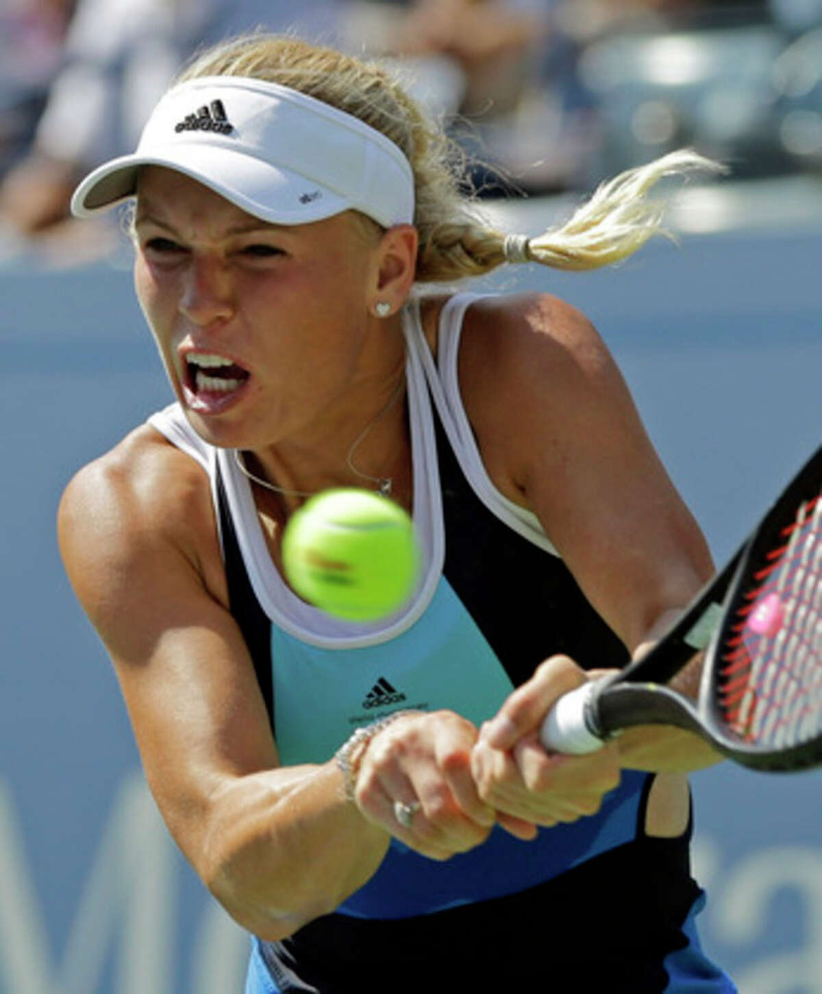 Caroline Wozniacki, of Denmark, returns a shot to Ying-Ying Duan, of China, during the first round of the 2013 U.S. Open tennis tournament Tuesday, Aug. 27, 2013, in New York. (AP Photo/Mike Groll)