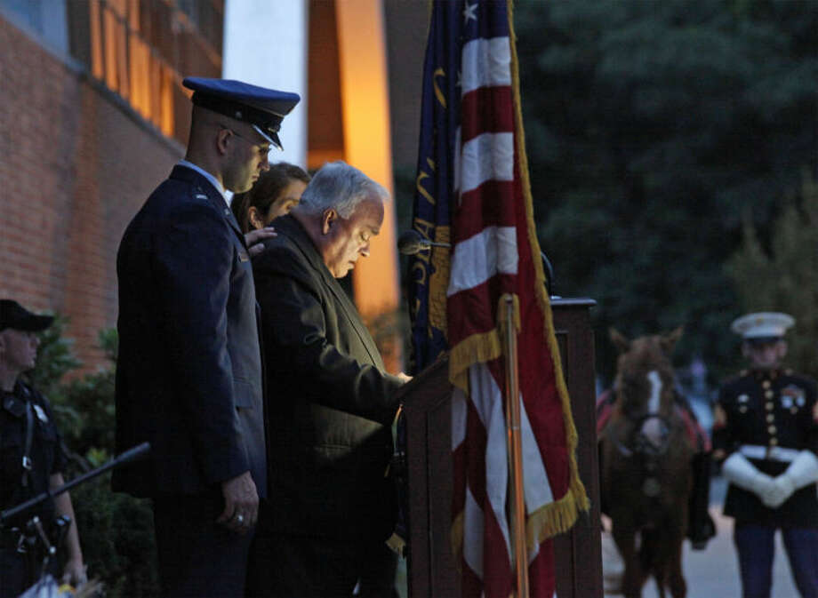 Father Richard F. Futie speaks during a vigil held in honor of a Navy SEAL from Stamford who was killed in Afghanistan. Futie died suddenly while scuba diving in Mexico on Aug. 25.
