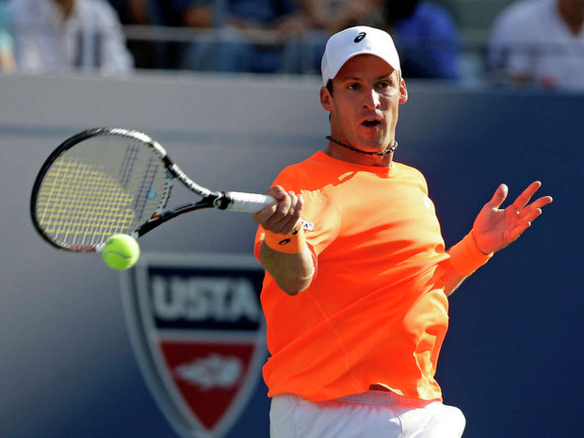 Grega Zemlja, of Slovenia, returns a shot to Roger Federer of Switzerland during the first round of the 2013 U.S. Open tennis tournament Tuesday, Aug. 27, 2013, in New York. (AP Photo/Mike Groll)