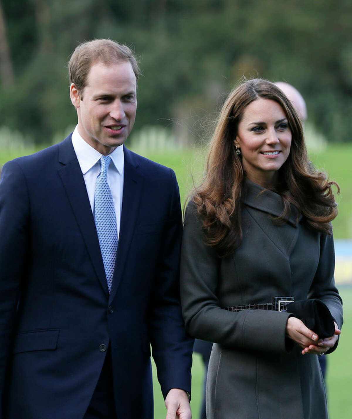AP file photo Britain's Prince William, left, and his wife Kate, the Duchess of Cambridge, visit a football training pitch at St George's Park near Burton Upon Trent in Staffordshire, England, in this file photo dated Tuesday, Oct. 9.