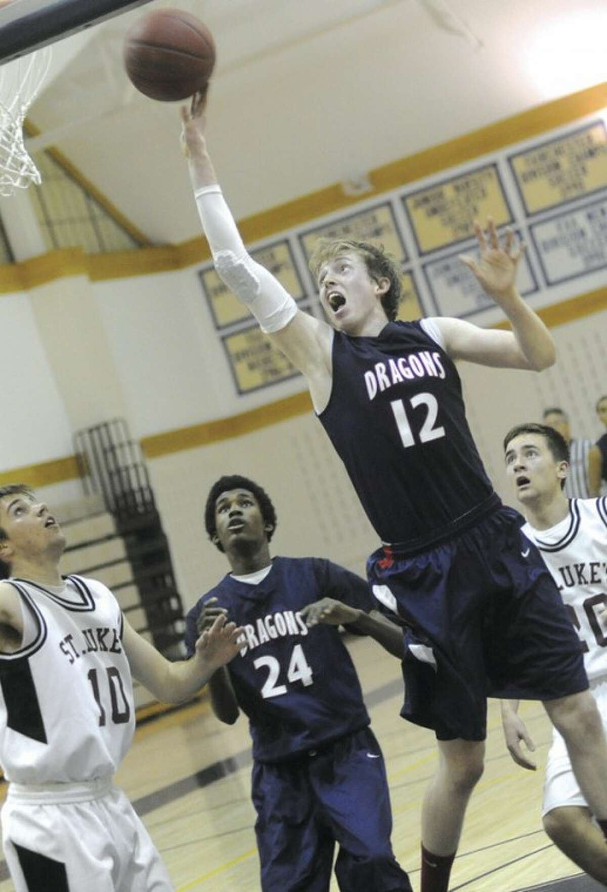 Patrick Ryan (12) of Greens Farms Academy goes up for a shot during Monday's season-opening game against St. Luke's. Ryan collected 15 points in the Dragons' 75-60 victory. Hour photo/ Matthew Vinci