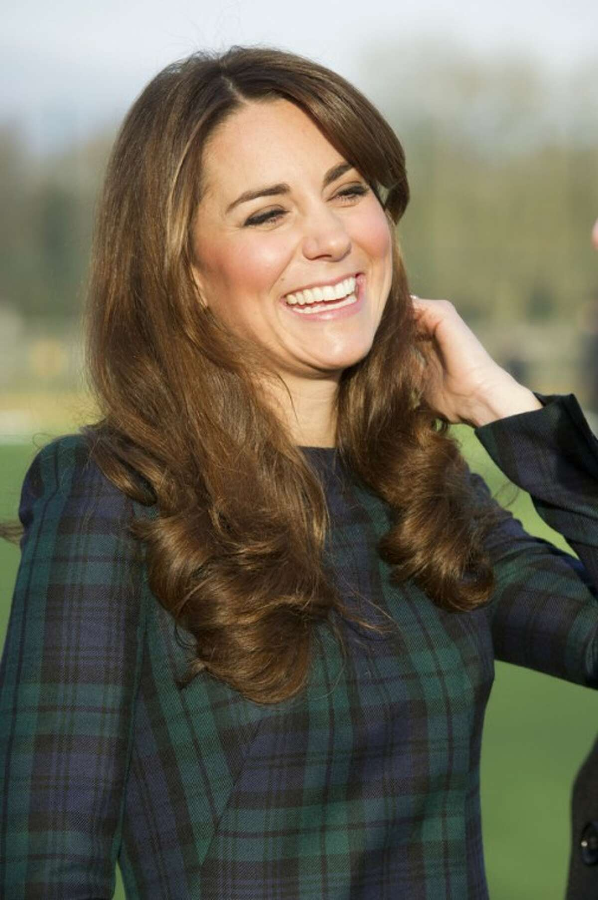 FILE - Kate, the Duchess of Cambridge seen during her visit to St. Andrew?'s School, where she attended school, in Pangbourne, England, in this file photo dated Friday, Nov. 30, 2012. The Duke and Duchess of Cambridge are very pleased to announce that the Duchess of Cambridge is expecting a baby, St James's Palace officially announced Monday Dec. 3, 2012. (AP Photo/Arthur Edwards, File)