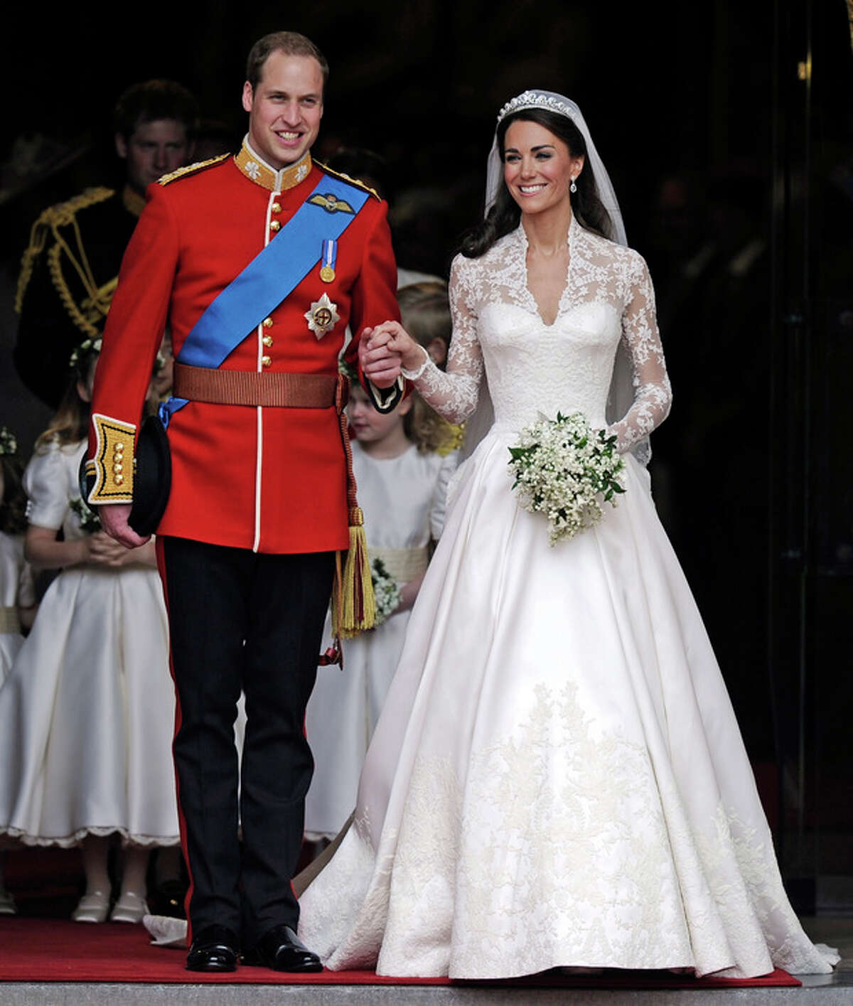 FILE - In this Friday April 29, 2011 file photo Britain's Prince William and his bride Kate, Duchess of Cambridge, leave Westminster Abbey, London, following their wedding. The Duke and Duchess of Cambridge are very pleased to announce that the Duchess of Cambridge is expecting a baby, St James's Palace officially announced Monday Dec. 3, 2012. (AP Photo/Martin Meissner, File)
