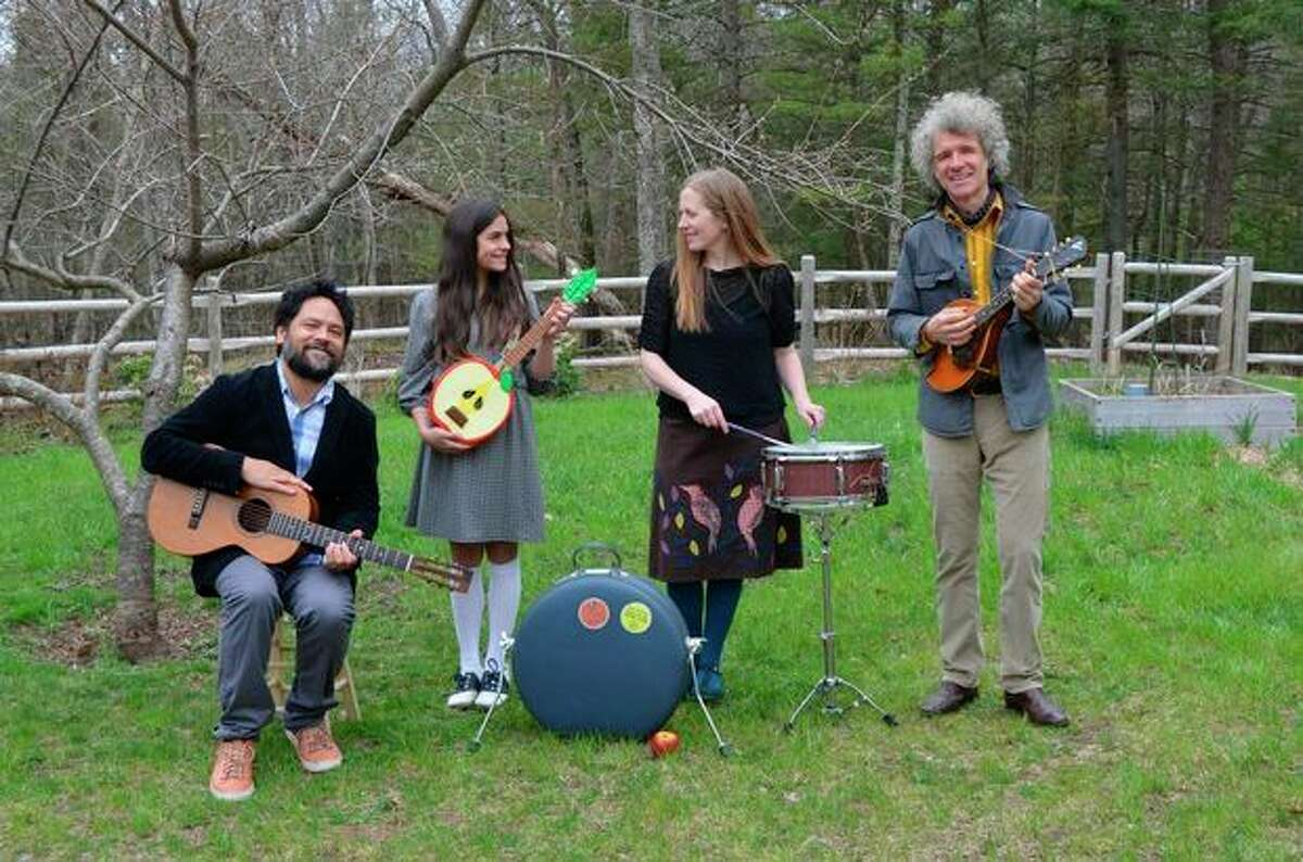 AP Photo/Blake Zidell & Associates, Stephanie Mayers This April 2013 photo taken in Woodstock, N.Y. and provided by Blake Zidell and Associates shows, from left, Daniel Littleton, Storey Littleton, Elizabeth Mitchell and Dan Zanes. All have collaborated on the new album