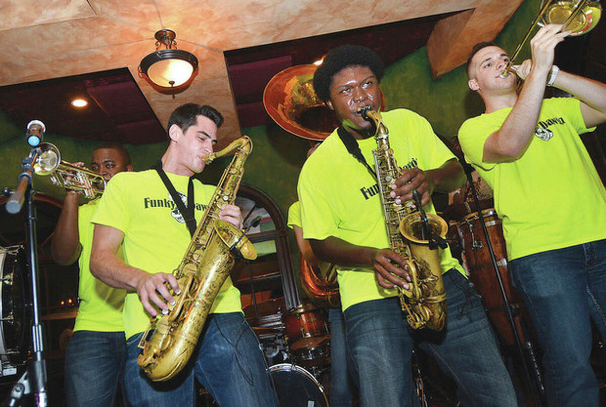 Hour Photo/Alex von Kleydorff Funky Dawgz plays O'Neils at The Hour's Breaking The Band in South Norwalk.