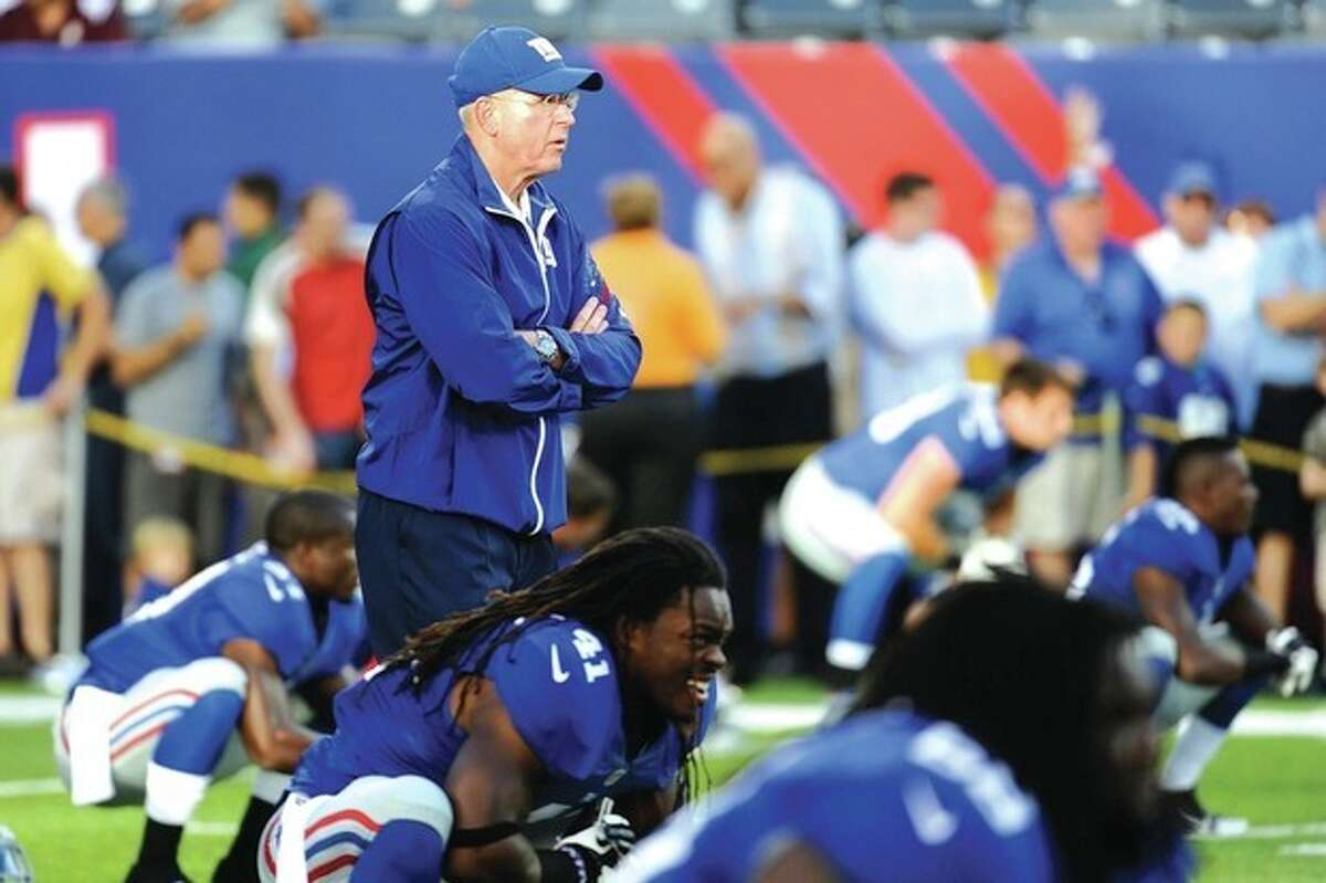 AP photo New York Giants head coach Tom Coughlin looks on as players stretch before a recent preseason game. The Giants have been the NFC East's best team over the past five seasons and seem to face fewer questions than their divisional opponents this year.