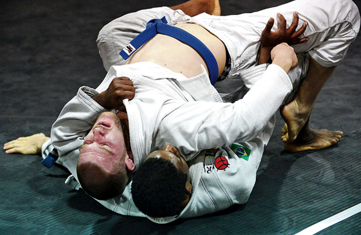 Joey Kay battles his opponent in Ju jitsu match as part of EG Sports benefit to raise awareness on human trafficking Saturday night.