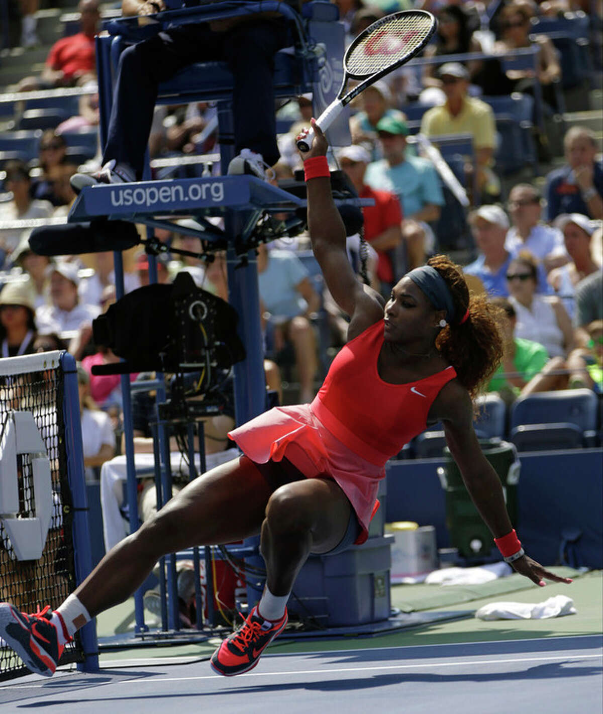Serena Williams falls after an off-balance shot against Galina Voskoboeva of Kazakhstan during the second round of the 2013 U.S. Open tennis tournament, Thursday, Aug. 29, 2013, in New York. (AP Photo/Kathy Willens)